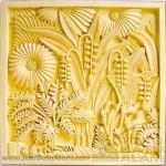 relief ukiran batu alam motif bunga matahari