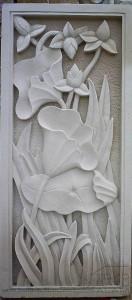 relief  ukiran batu alam motif bunga teratai
